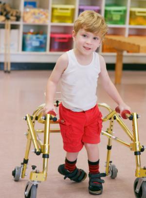 little boy on walker