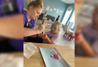 Child painting in class